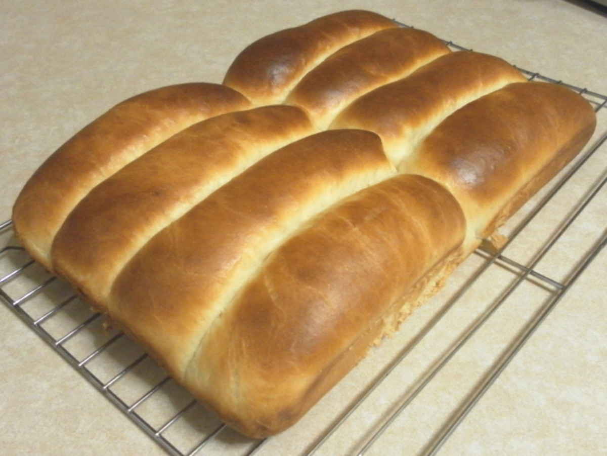 Row buns cooling on a rack.