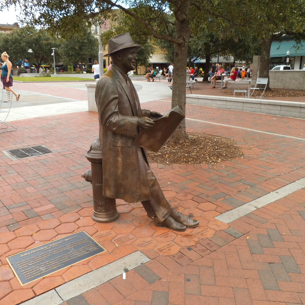 This bronze figure is in Savannah, Georgia. Although the man reading the newspaper while leaning against a fire hydrant isn't in front of a library, it would have been perfect for such a location.