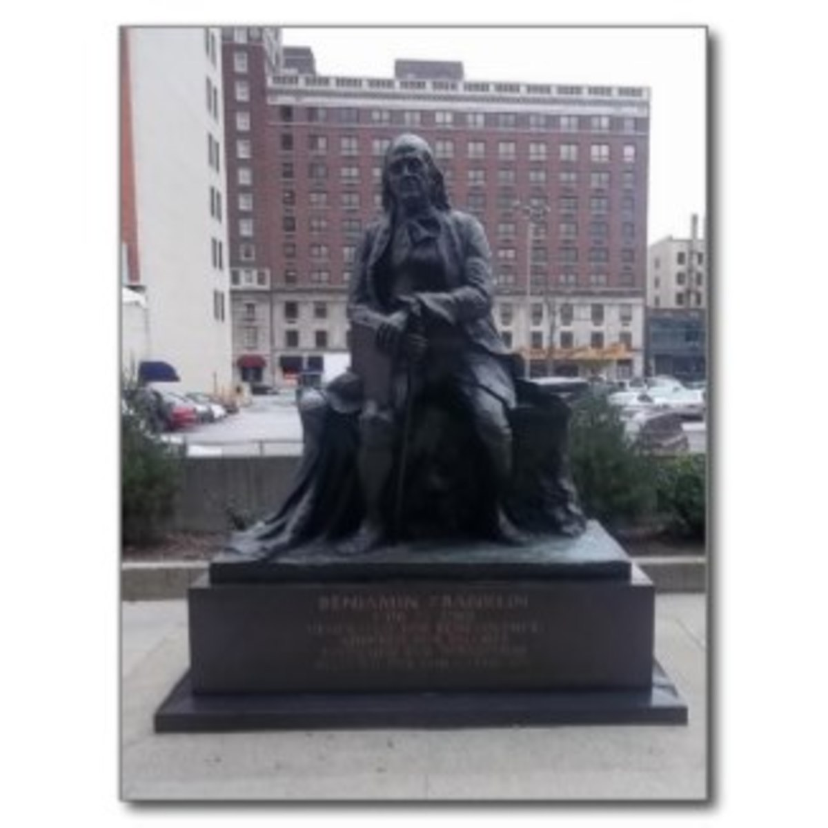 Benjamin Franklin started the first library in Philadelphia so he's a natural for a library statue.