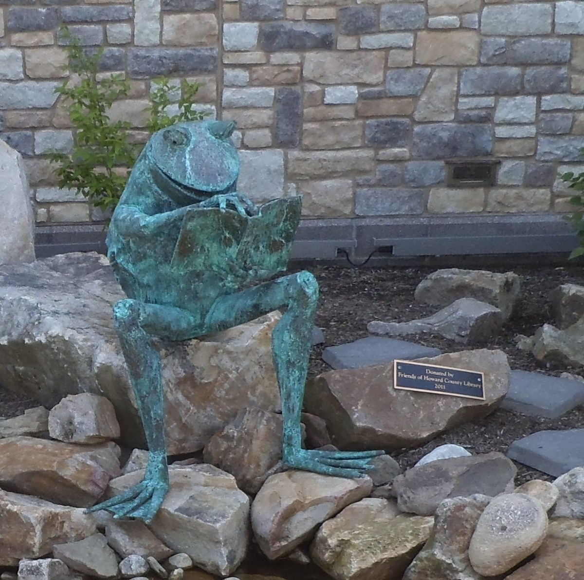 This playful frog reading a book is outside a library in Maryland. Notice the plaque telling who donated the figure.