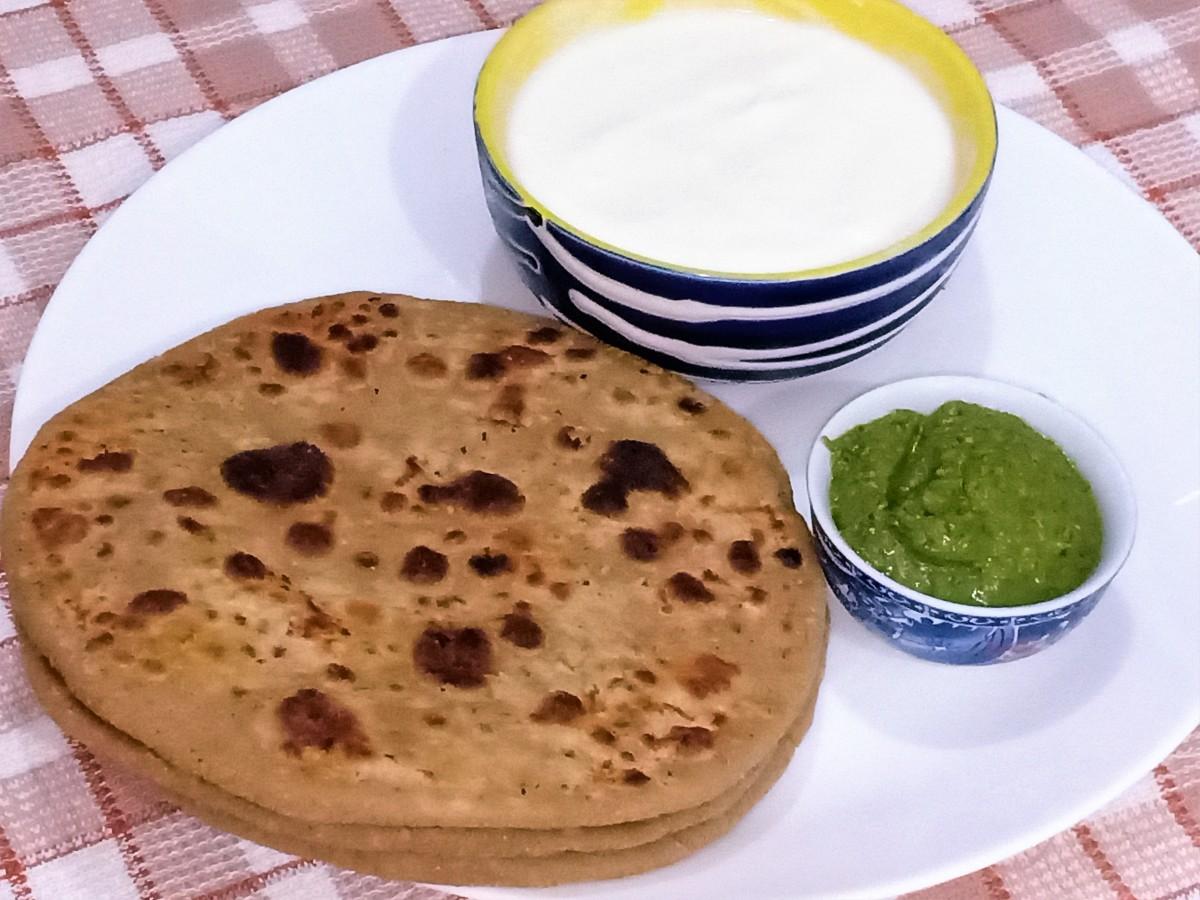 Bihari sattu paratha served with yogurt and mint chutney