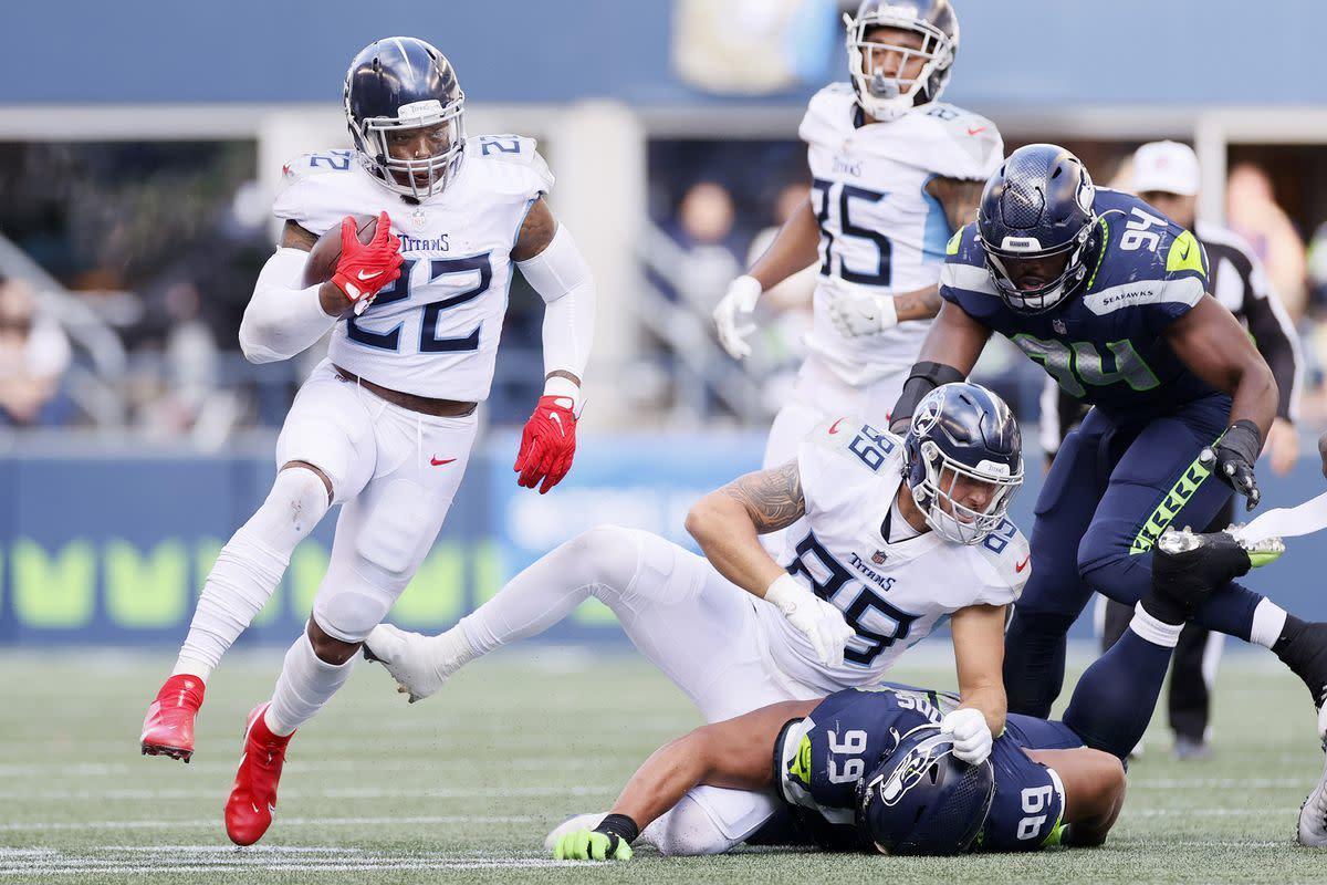 Derrick Henry runs wild (182 Yds, 3TDs) as Titans outlast Seahawks in OT 33–30.