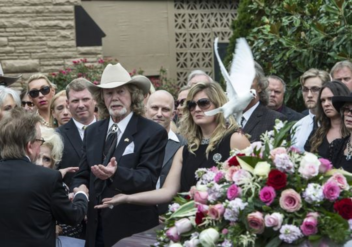 Family members of Lynn Anderson release a dove by her casket after the service on Wednesday