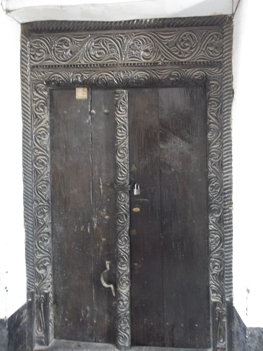 An ornately curved Lamu door