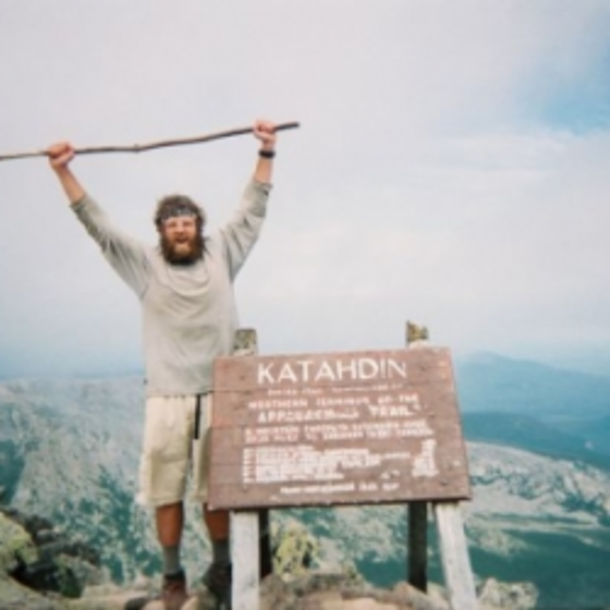 An A.T. thru-hiker completing the trail on Maine's Mt. Katahdin