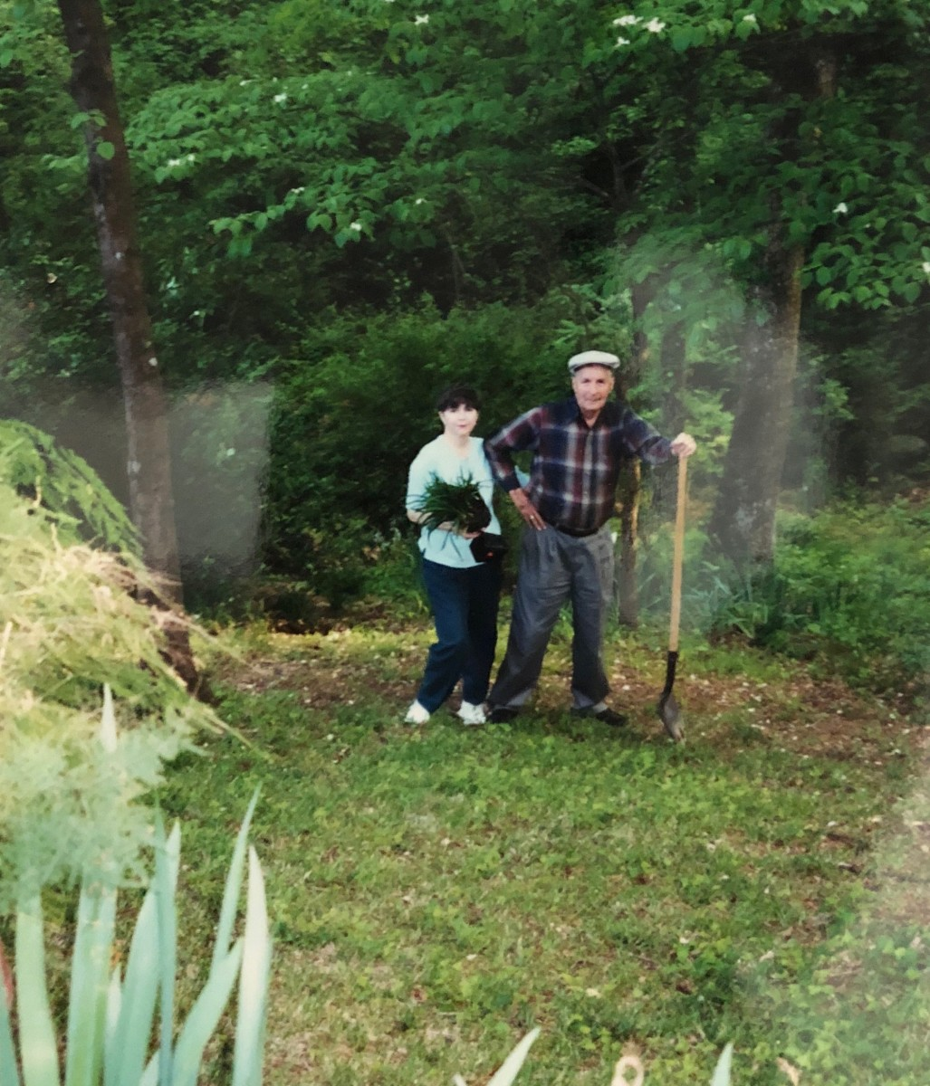 This is my dad and me. We had dug up some plants for me to put in my yard. By this time, he had grown too old to keep the entire hillside clear of underbrush, and I lived too far away (400 miles) to help.