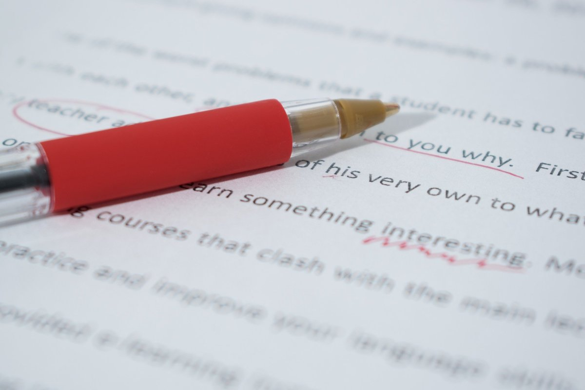 Red pen marking corrections on paper