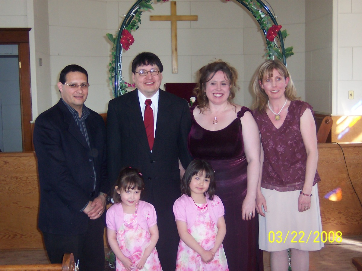 You can see the archway in the background. My husband and I are in the middle, with my sister and her family.