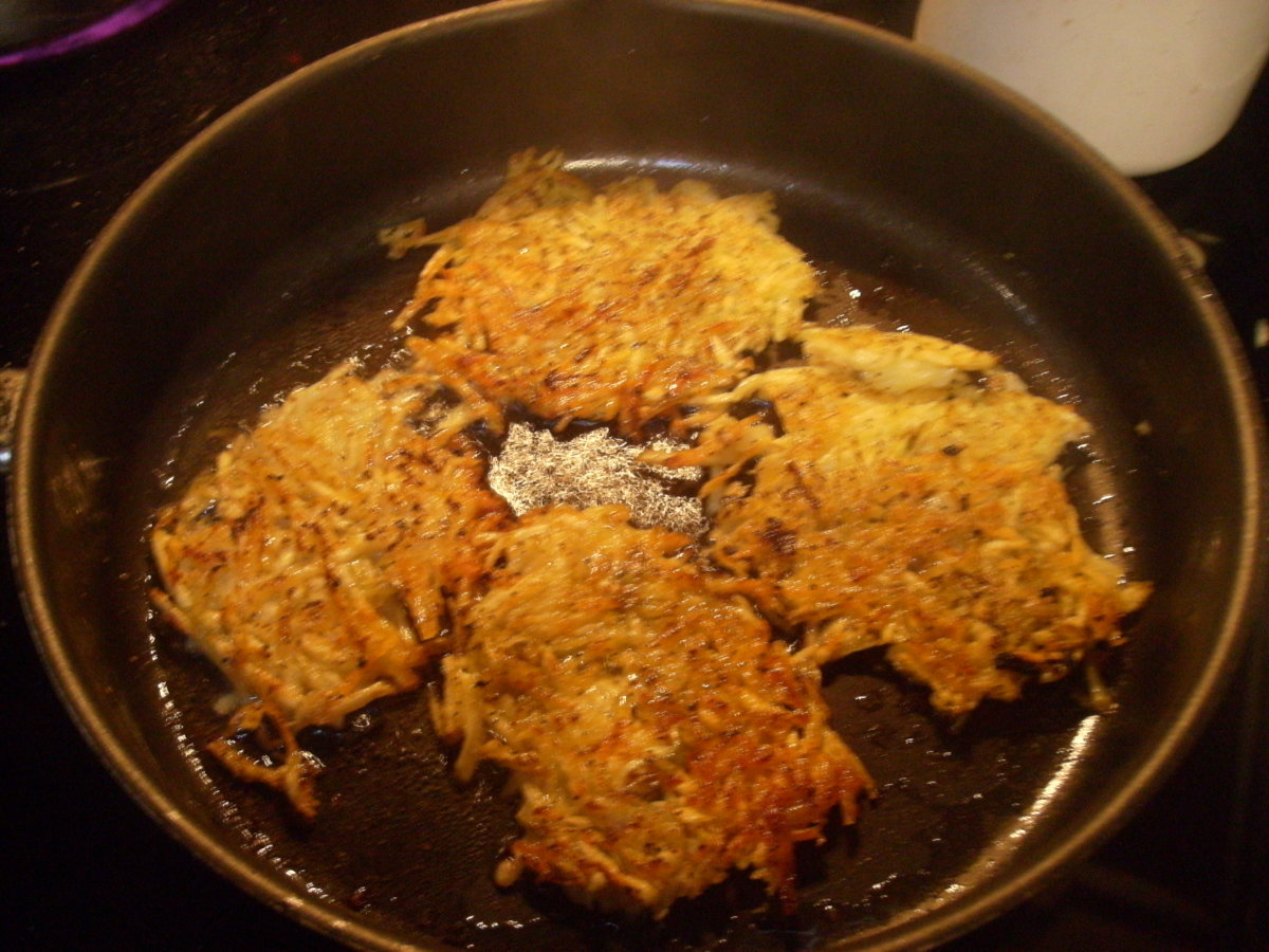 Brown shredded homemade hash browns in the pan.