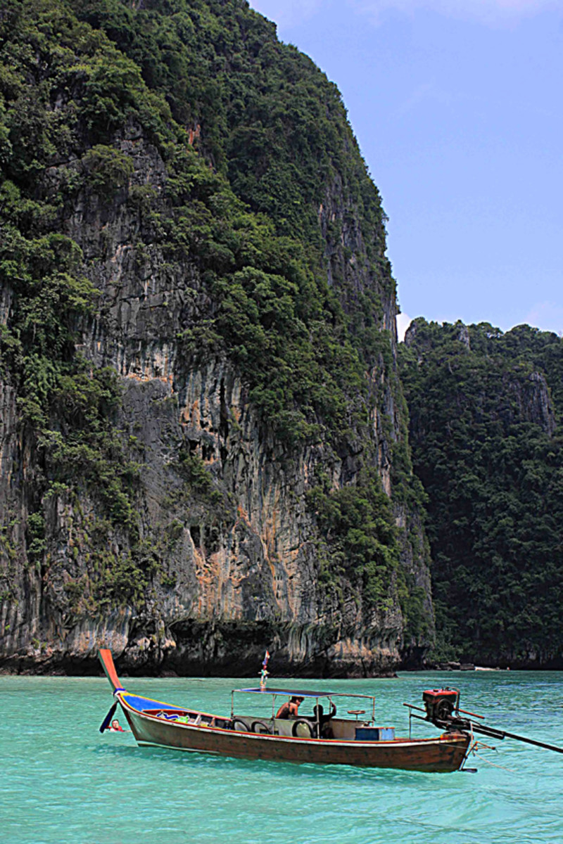Long-tail boat in the Andaman Sea. This photo was taken in the Phi Phi Islands, where rock climbing, kayaking, snorkeling and diving, are all options to try
