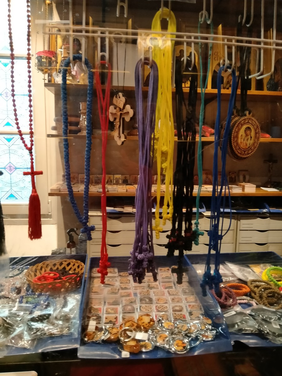 Oftentimes, Bogoroditsa would ask me to buy her necklaces from the kiosk, bring them to her and her son or leave them somewhere outside. Mary says she disperses dark spells with these. According to the clerk the crosses are imported from Serbia.