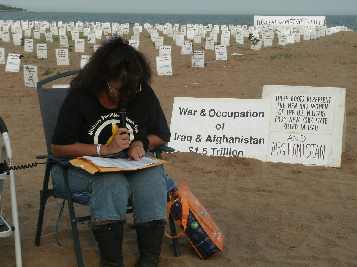 Elaine Brower of Military Families Speak Out - New York reads the names of U.S. military personnel whose lives have been taken in both the Iraq and Afghanistan occupations.