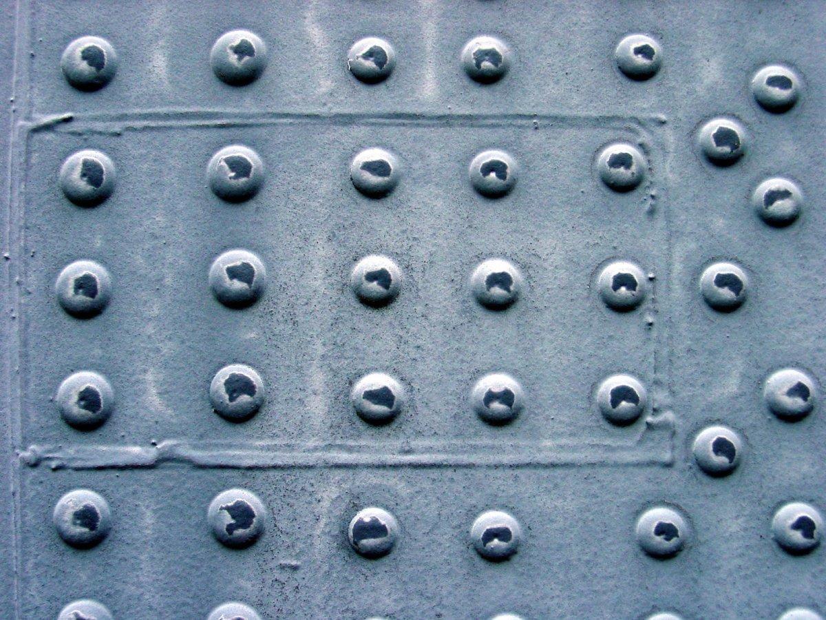 Rivets in metal panel