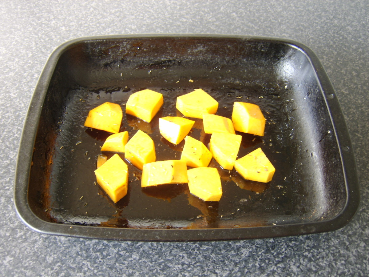 Chopped butternut squash prepared for roasting