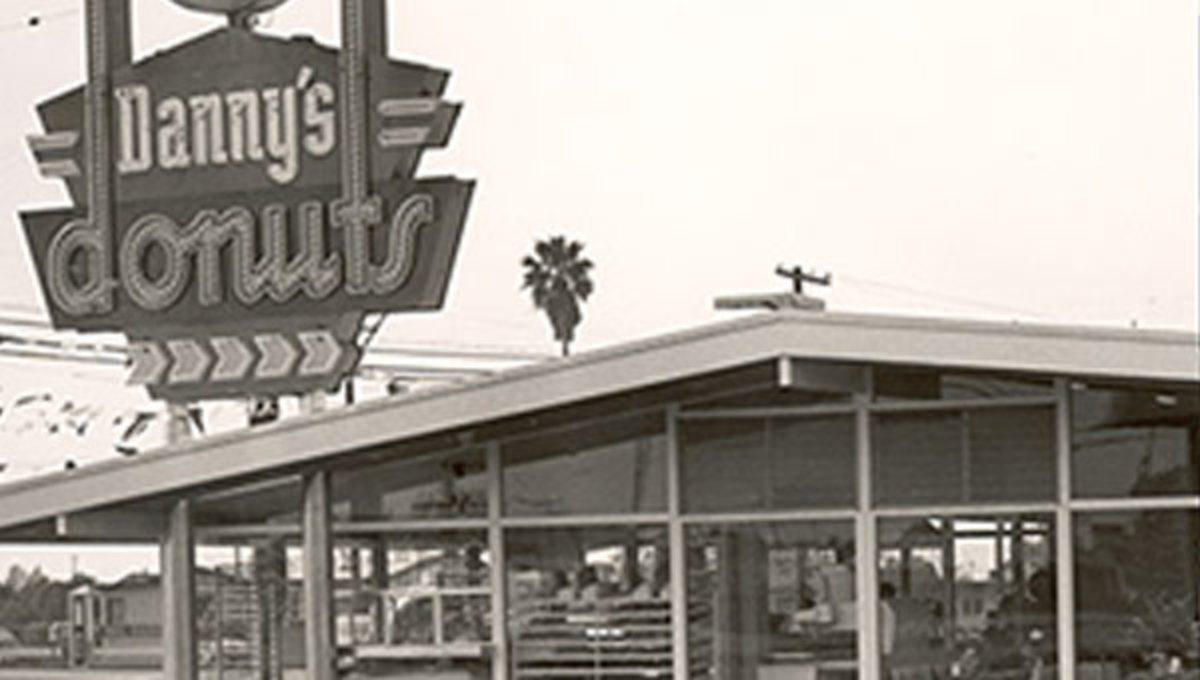 In 1953, the first Danny's Donuts opened in Lakewood, California. Founded by Harold Butler and Richard Jezak, the name was eventually changed to Danny's Coffee Shops, and then to Denny's Restaurants in 1959.