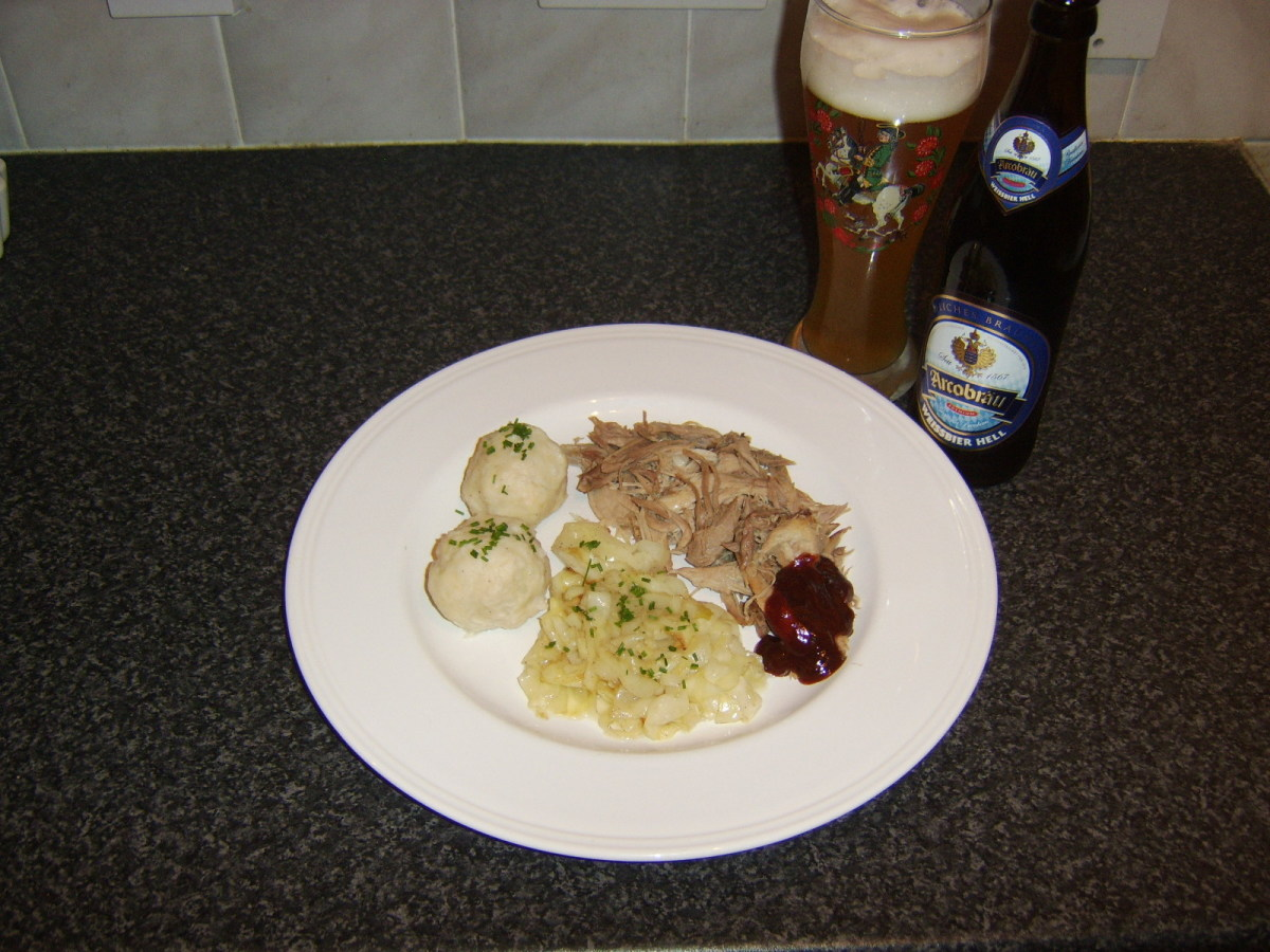 An authentic Bavarian weissbier is an excellent accompaniment to this pulled pork, German potato dumplings and braised cabbage dish