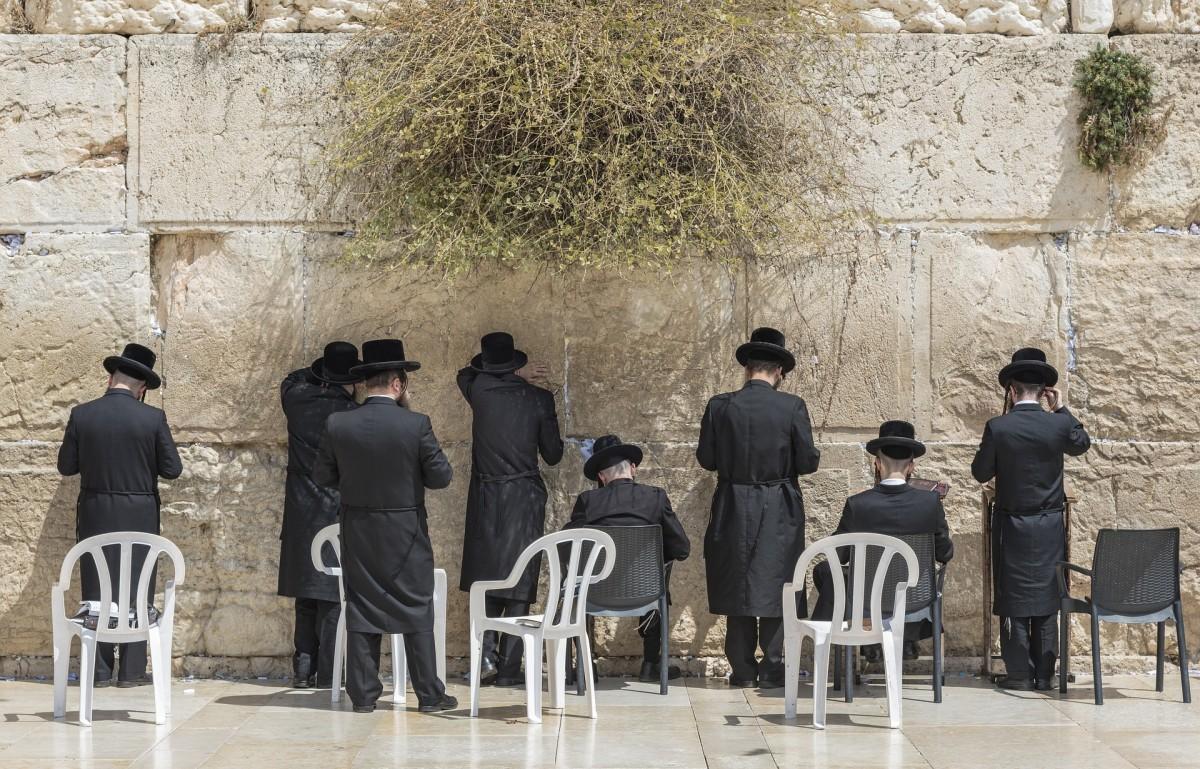 Jews praying at the Wailing Wall of Jerusalem