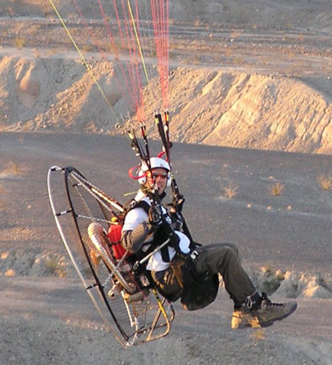 This is how the paramotors look like.  A parachute holds the whole motor and person from above.
