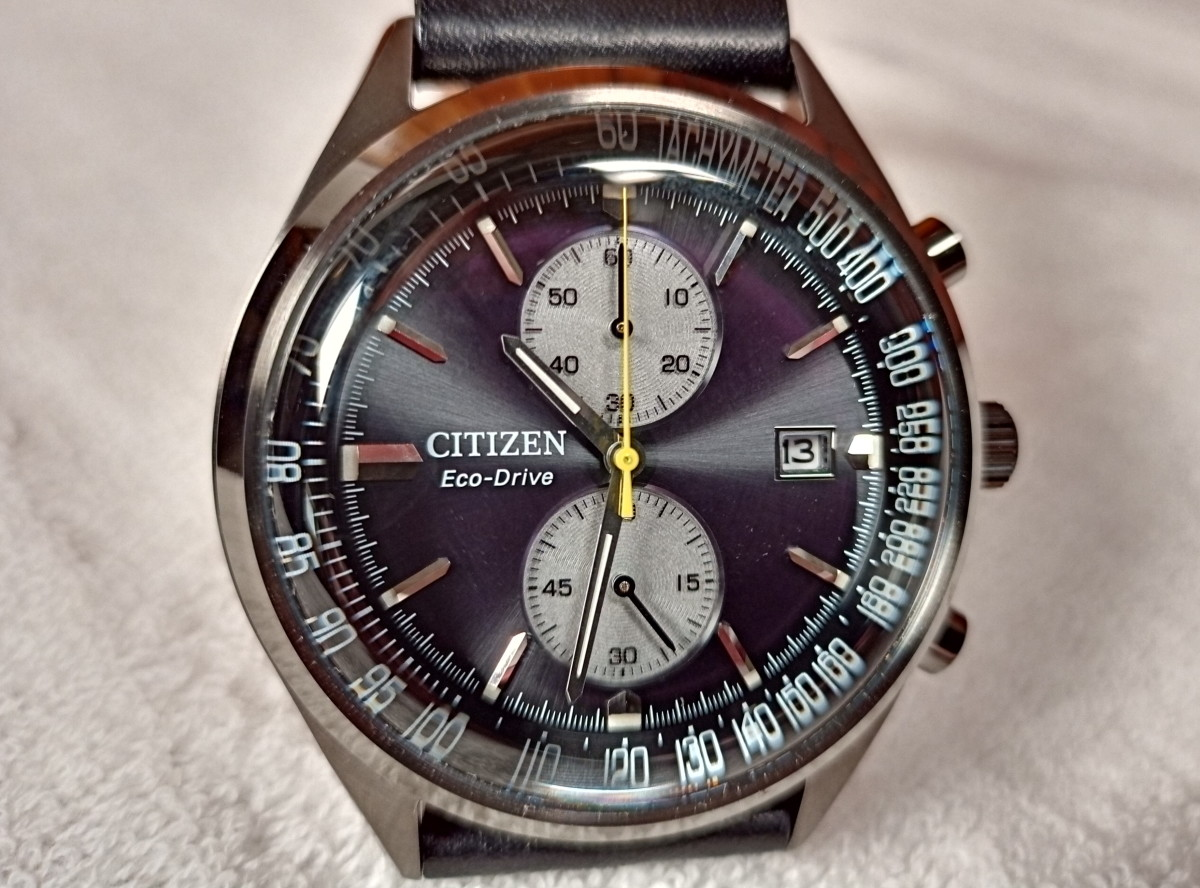 Close up of Citizen Eco-Drive watch.  Note that the curved crystal distorts color and detail when photographing