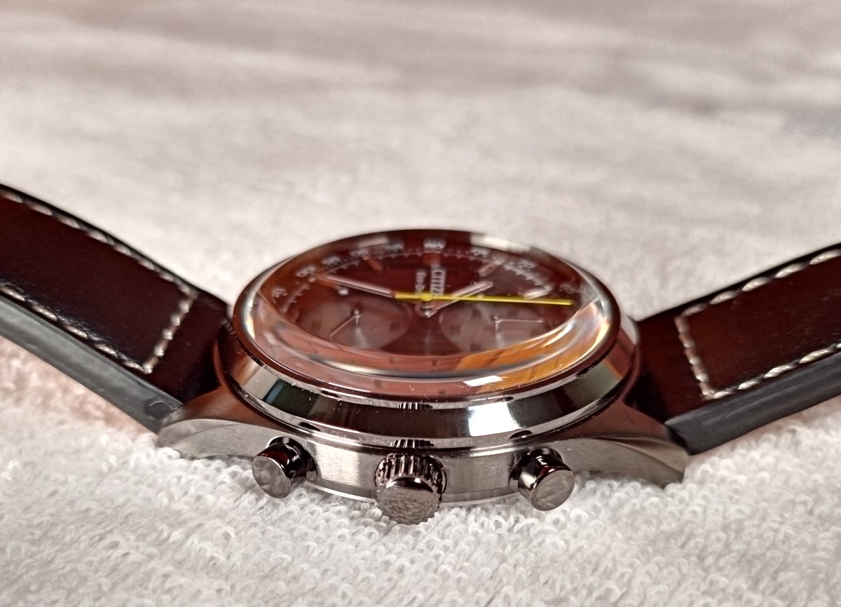 Crown is flanked by two pushbuttons intended to start, stop, and reset chronograph