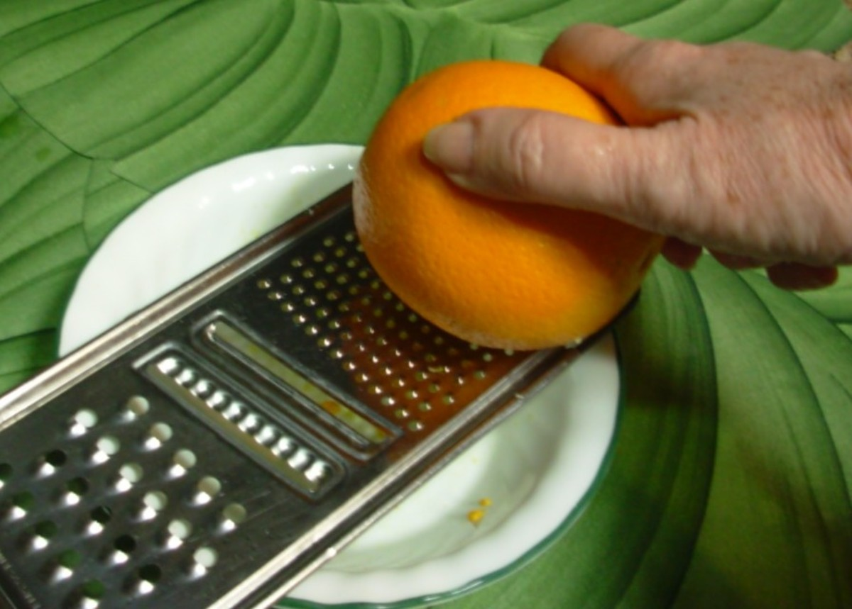 The orange rind is grated to produce orange zest.