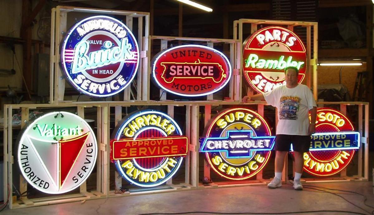 Automobilia - colorful advertising signs in bright red, yellow and royal blue advertising both service and product