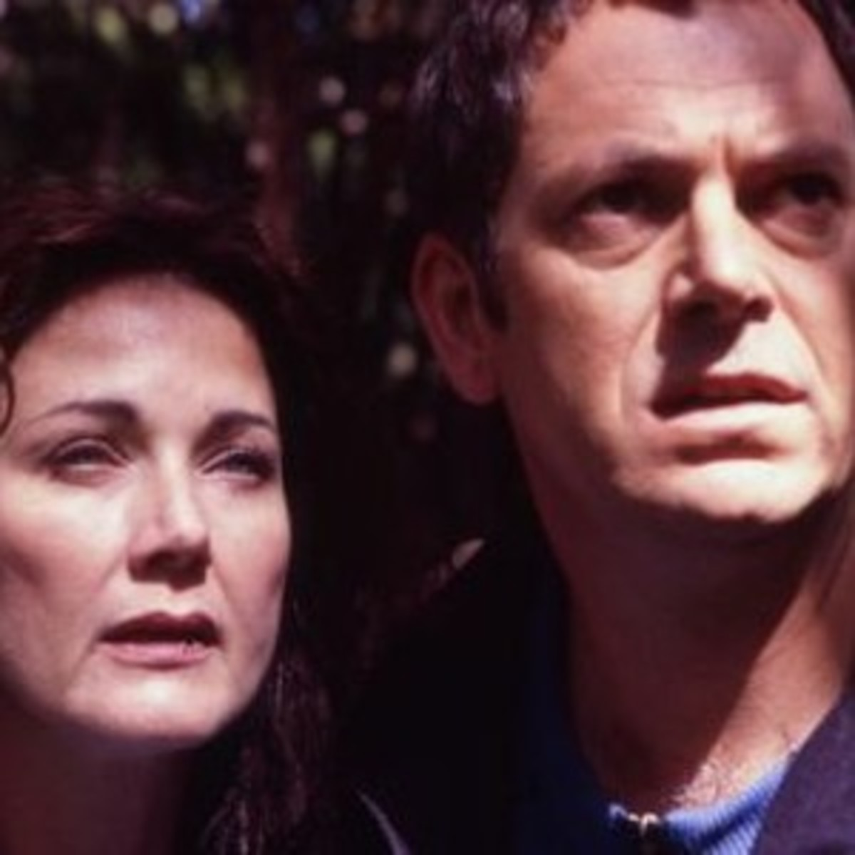 Dr. Janet Fraser (Lynda Carter) and Patrick (Peter Elliott) watch in horror as Mt. Extreme explodes