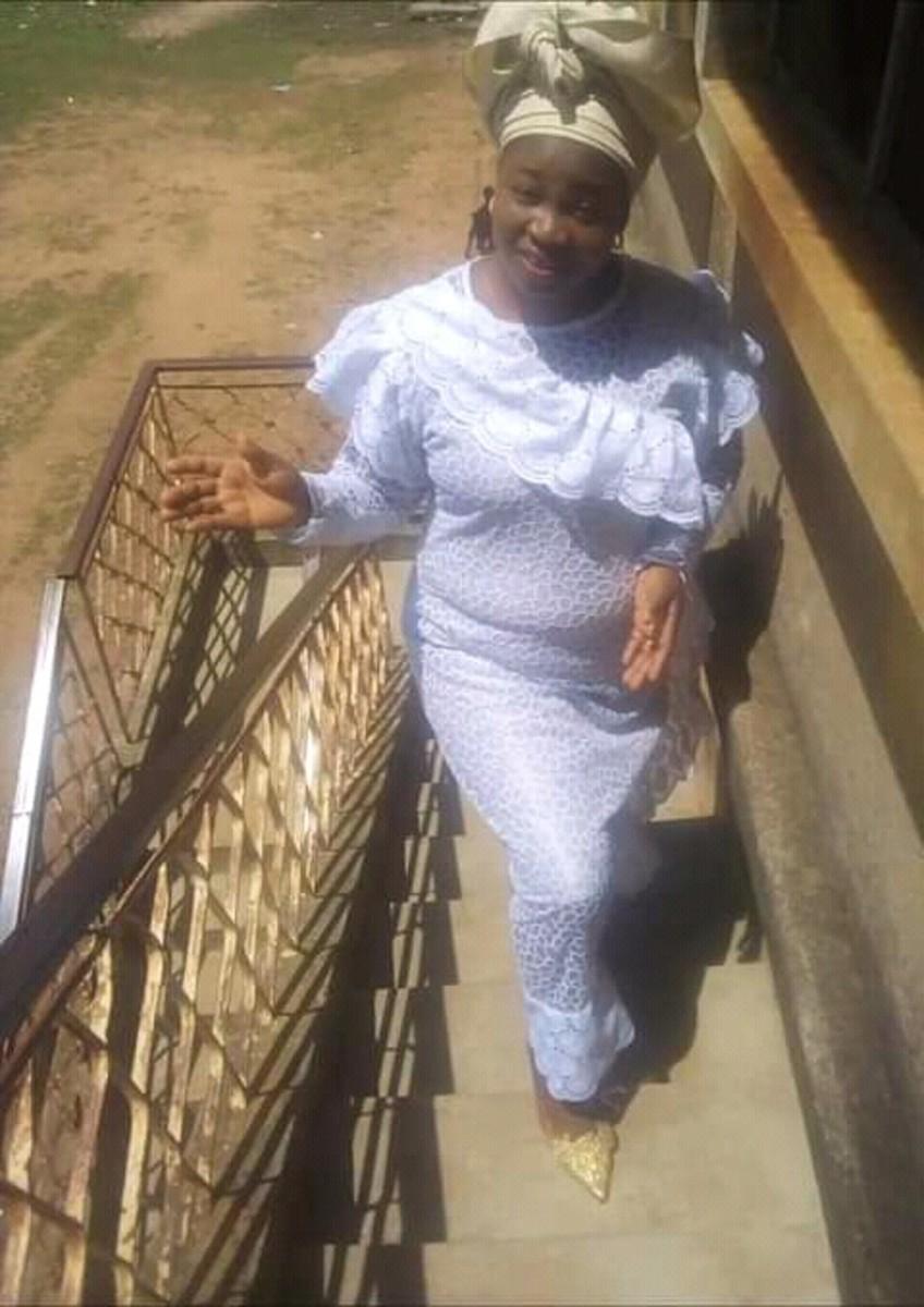 Mrs Ifeoluwa Ogidi, climbing staircase in Ilorin, Nigeria.