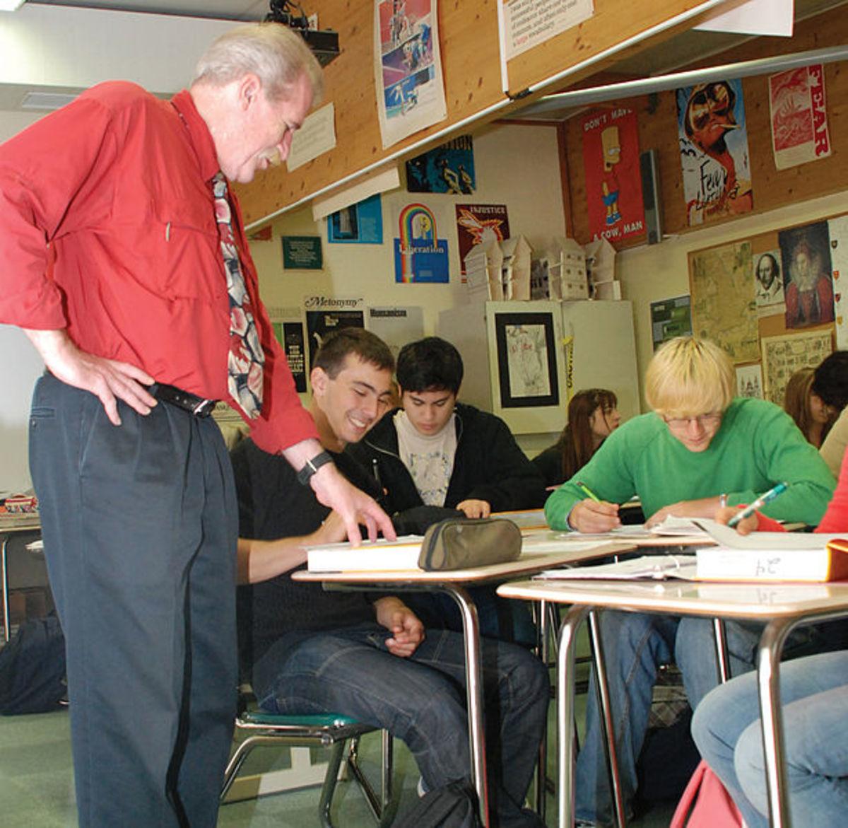 SHAPE teacher helps out teen student.