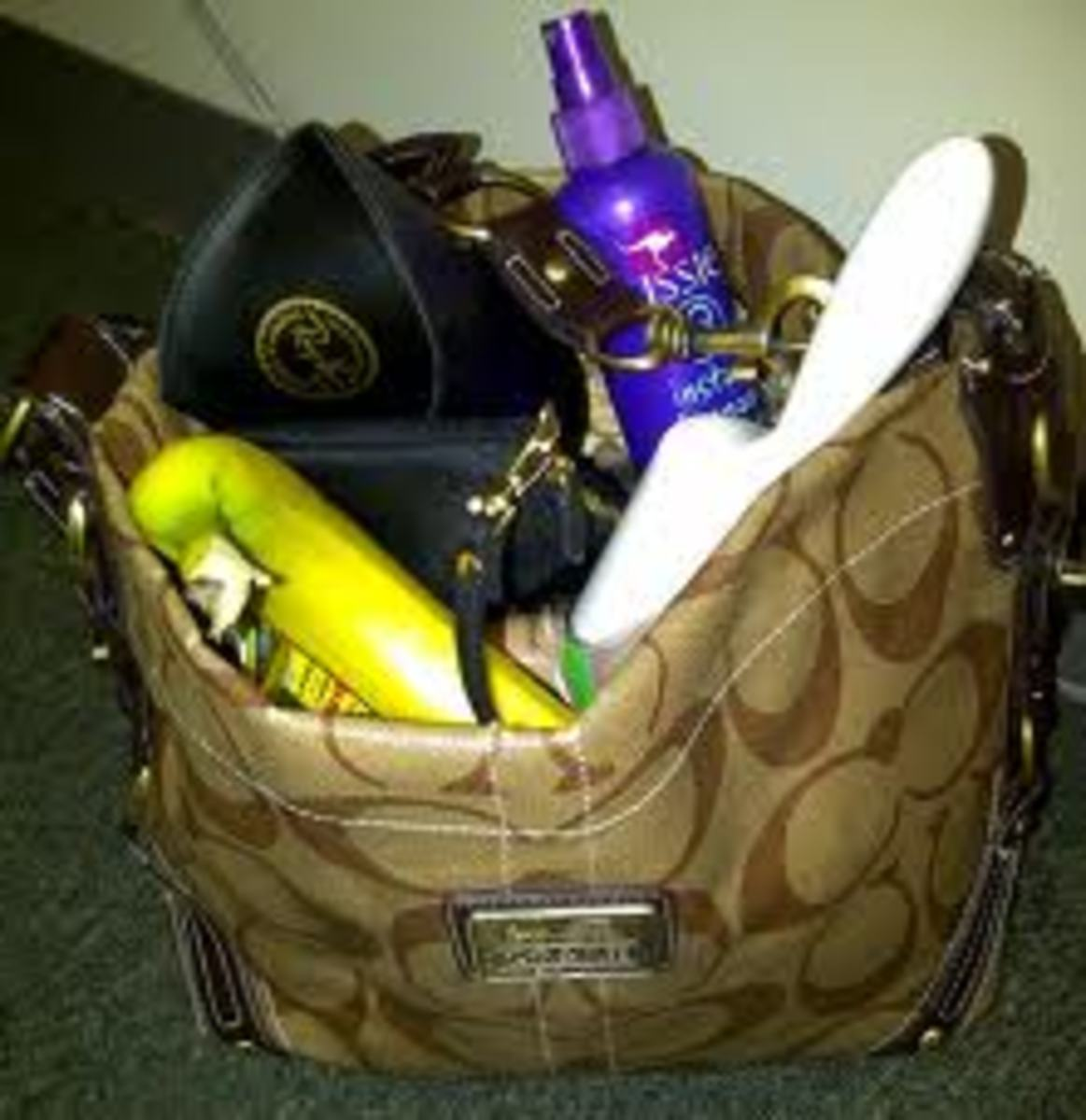 Arsenal of emergency supplies in a typical handbag.