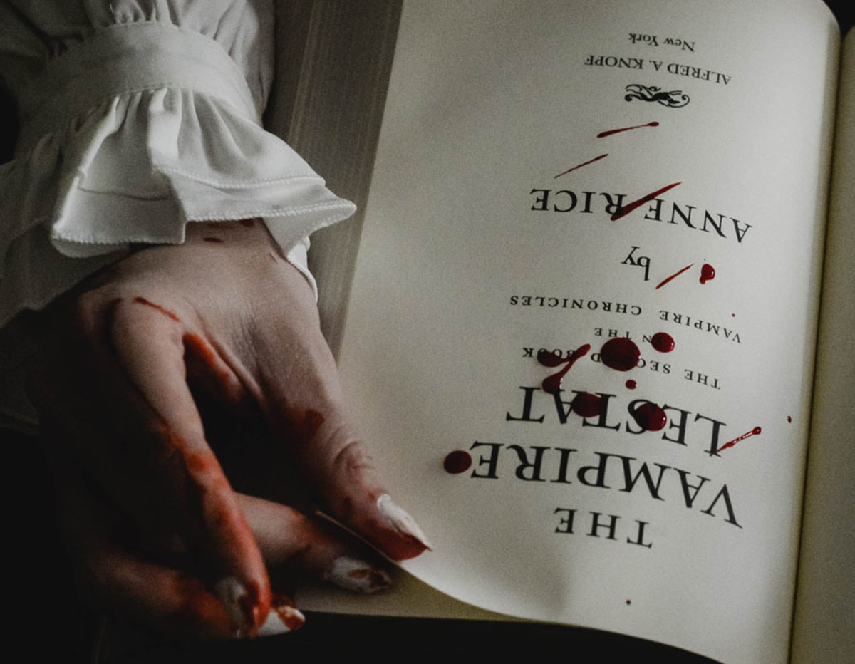Vampire reading a book.