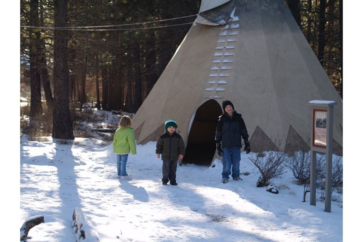 Children love to play in the teepees at the High Desert Museum (c) Stephanie Hicks