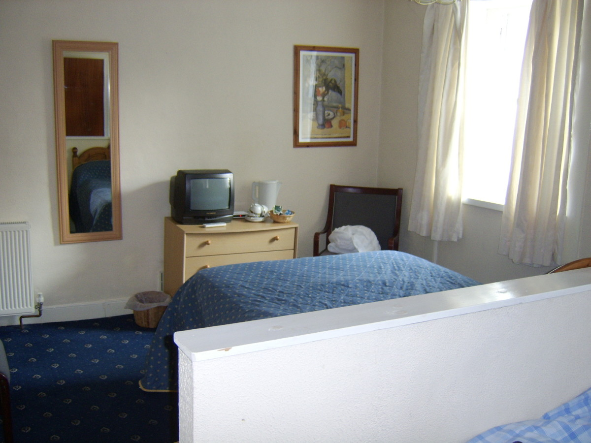View of just part of one of the spacious bedrooms in the Taynuilt Hotel