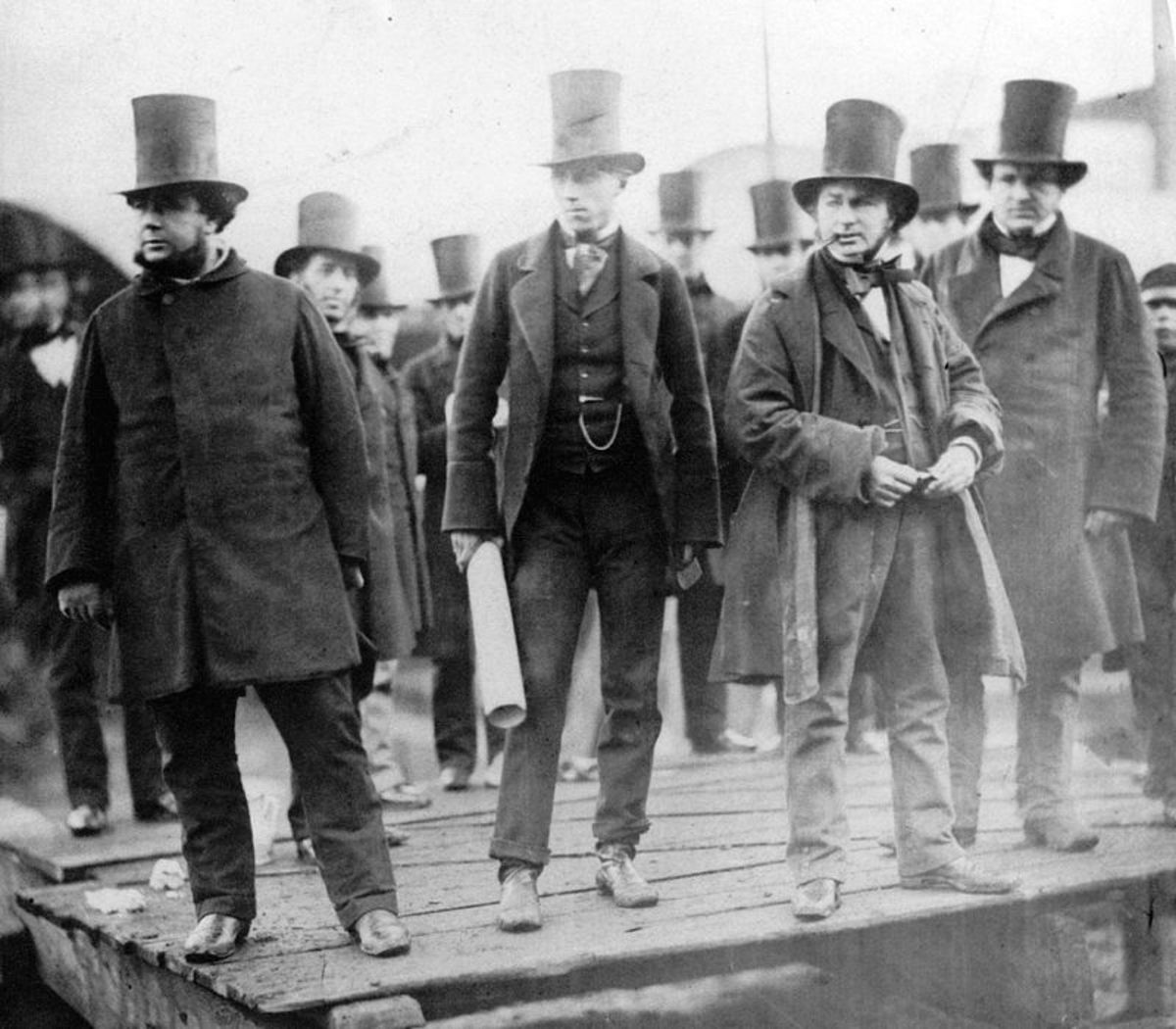 """The great British engineer Isambard Kingdom Brunel (second from right) and companions wearing the top hat style known as the """"stovepipe."""""""