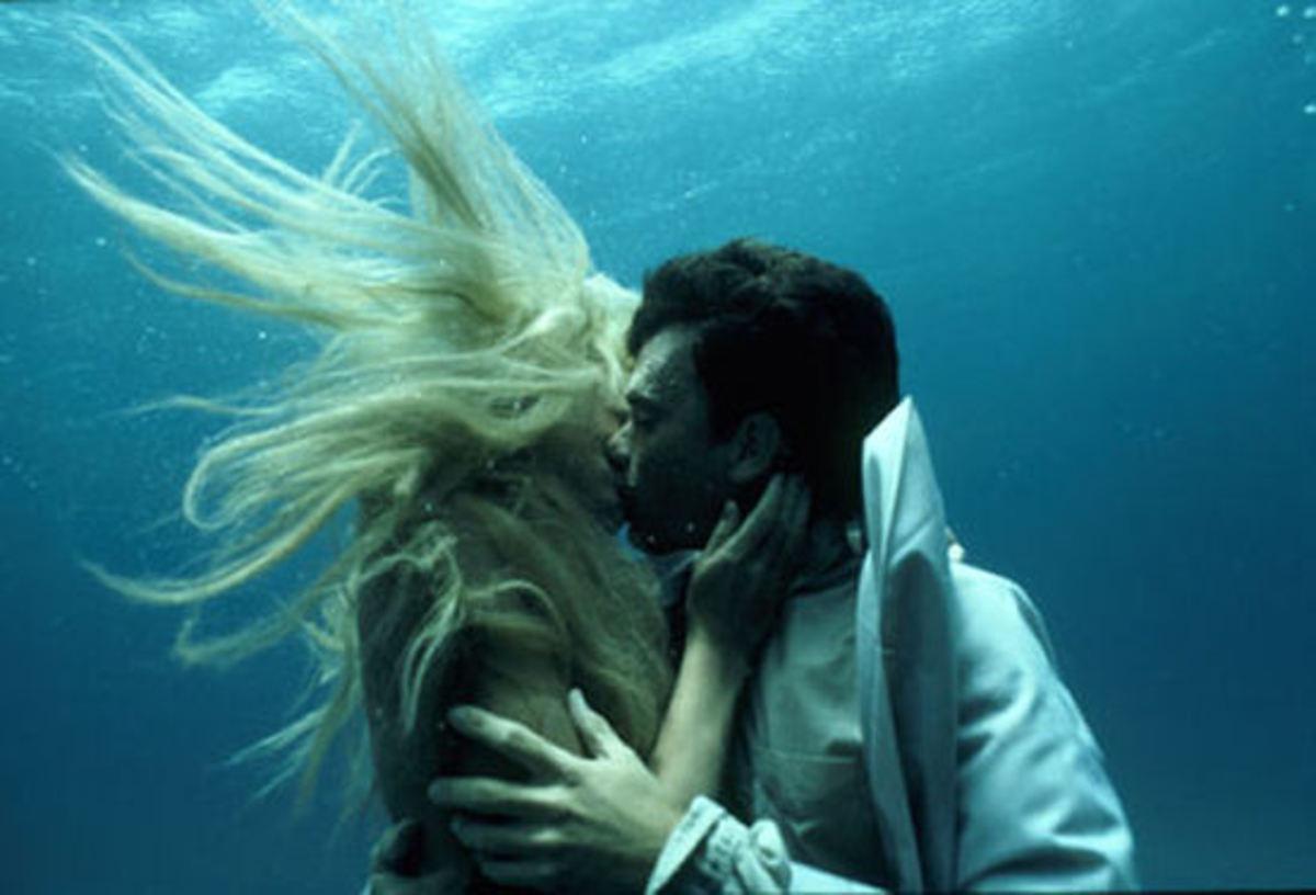 The mermaid Madison saving Allen's life again.