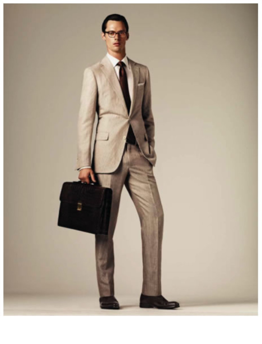 A suit in a light color. Notice that the tie balances the lightness of the suit.