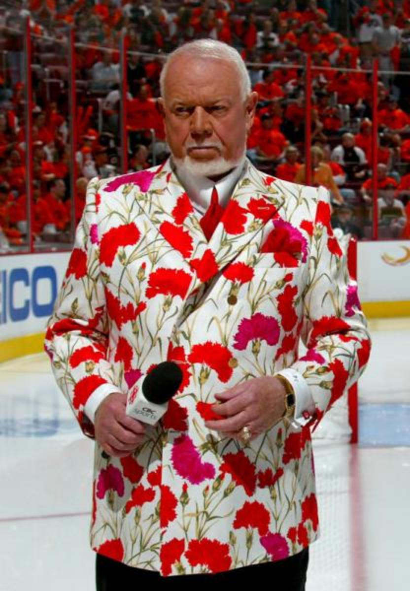 Don Cherry Rose might be able to pull it off, but this outfit will look ridiculous on most men. It is certainly not boring, but a little over the top. You can be elegant without exceeding.