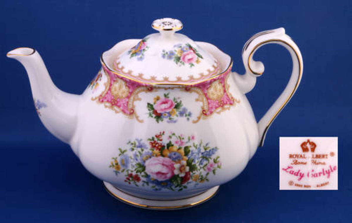 A Royal Albert Lady Carlyle Teapot, seconds qualtity (note scratch through backstamp), in new condition, sold on eBay for GBP 50