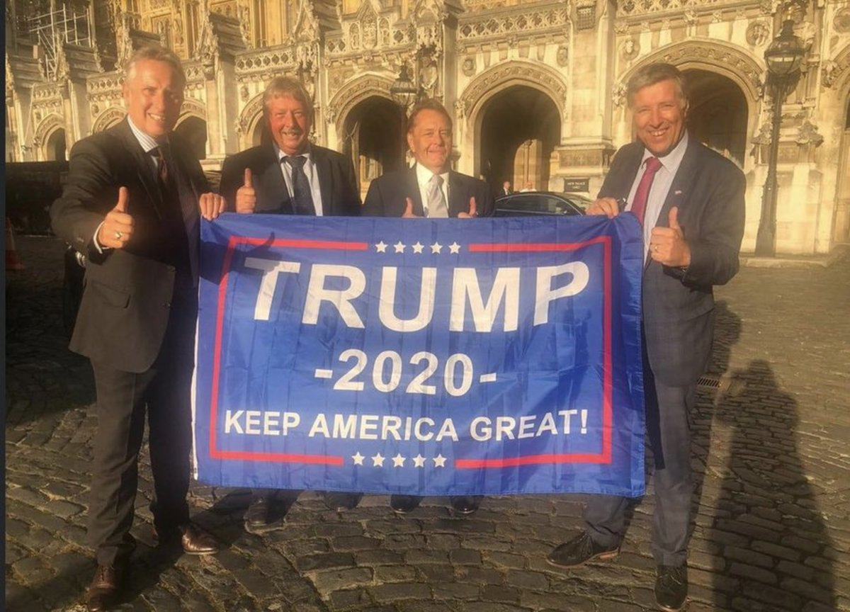 The loyalist far-right DUP Members of Parliament with a Trump banner outside Westminster