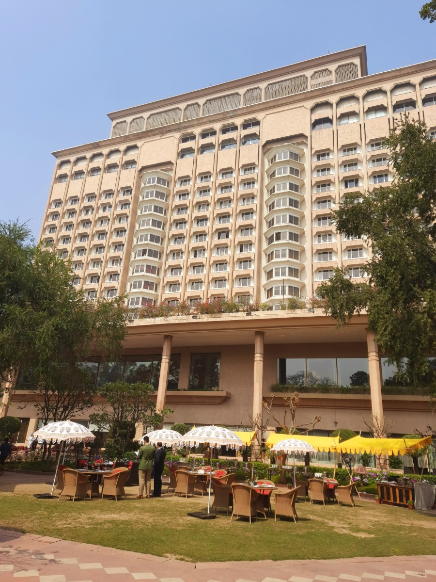 The back view of Taj hotel, Delhi, with the open air dining space, with greenery and flowers all around