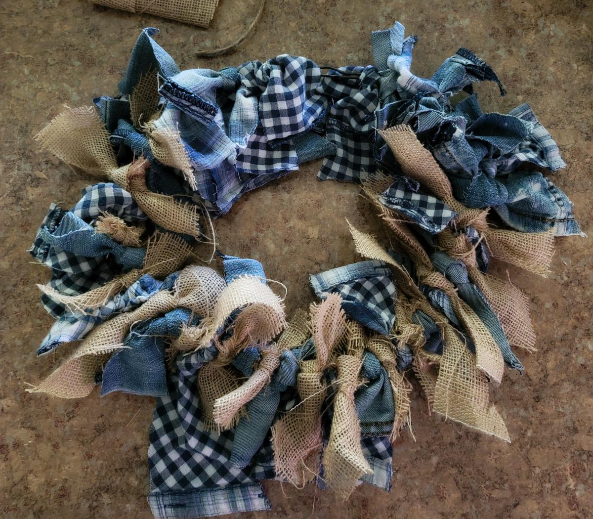 Tie fabric strips around wire hanger circle.