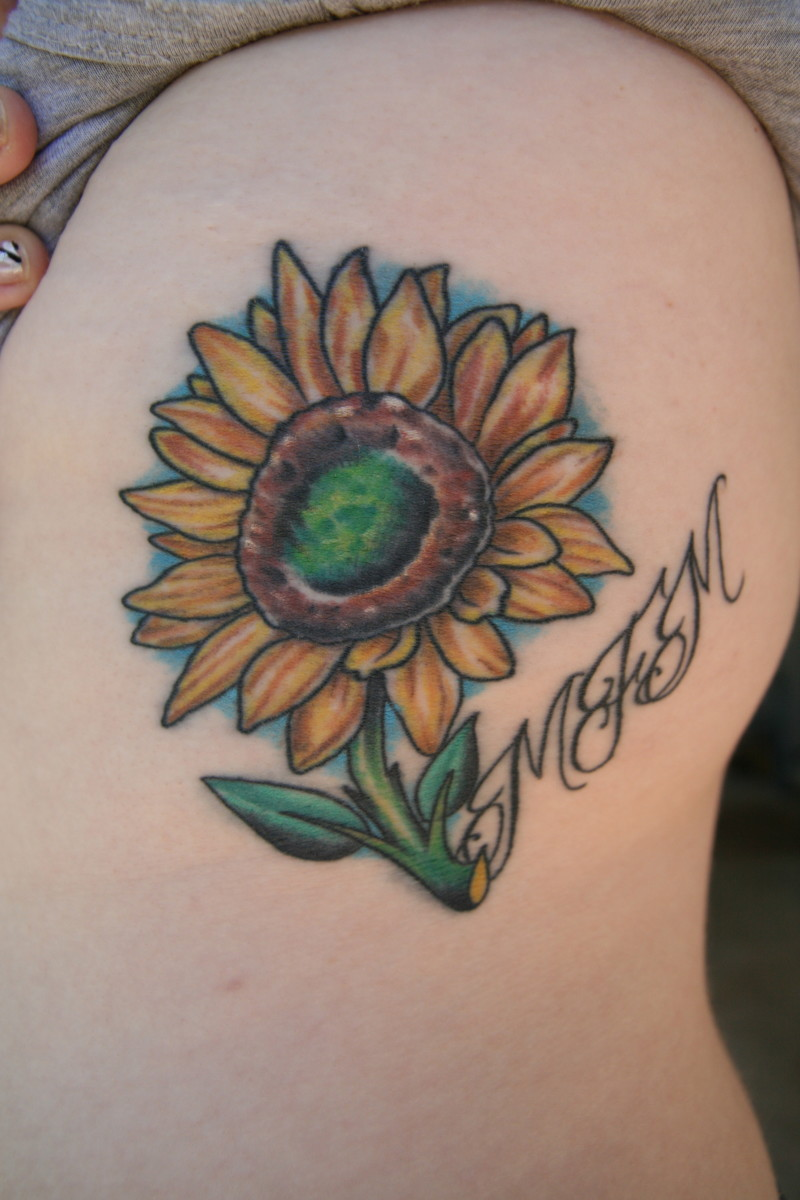 Sunflower tattoo with a phrase