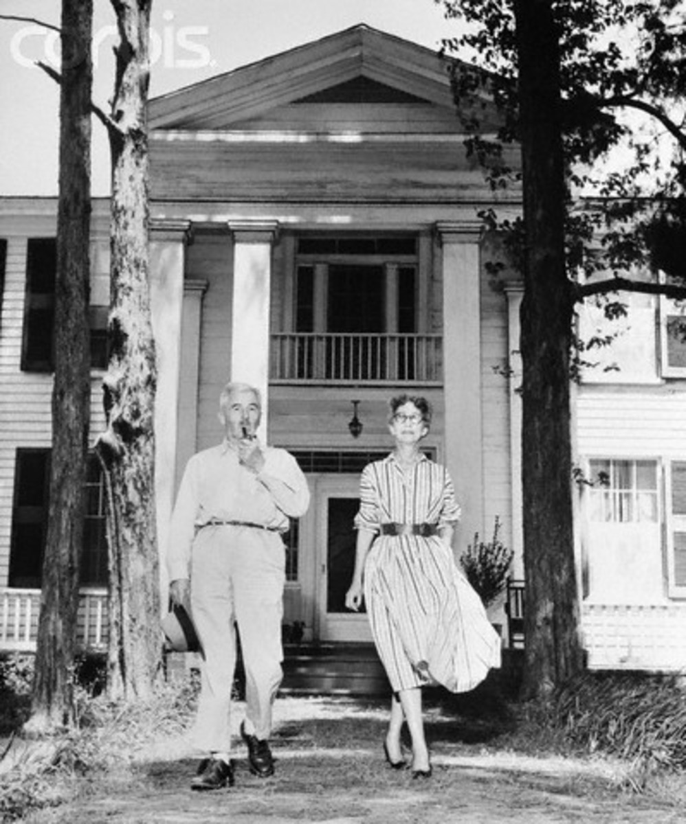 William Faulkner with his wife, Estelle, in front of their house.