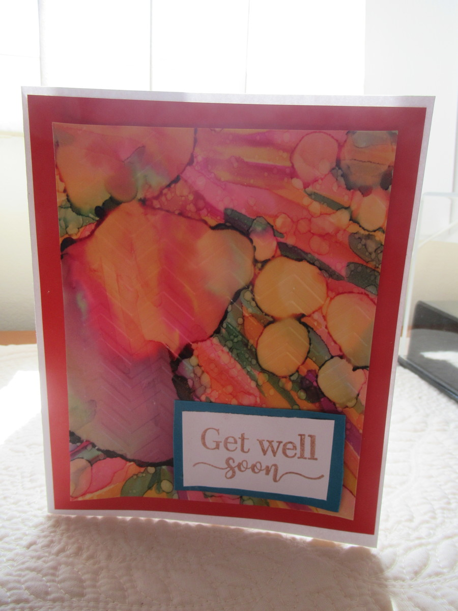 Have you ever considered doing alcohol inks on vellum? You can create cards, tags, scrapbook pages, overlays and more