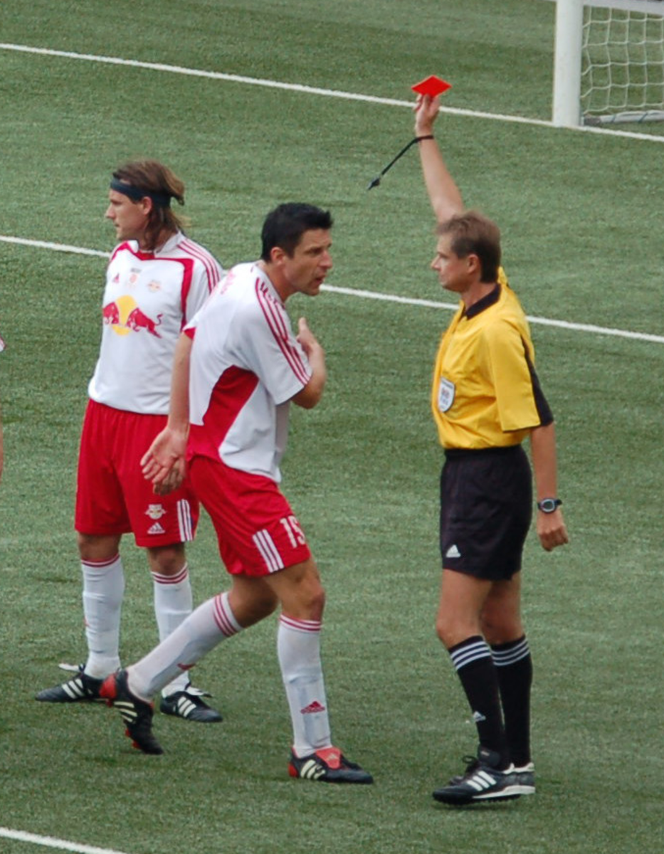 When the referee gives a player a red card, that player is dismissed from the match immediately. Coaches can also be given red cards.