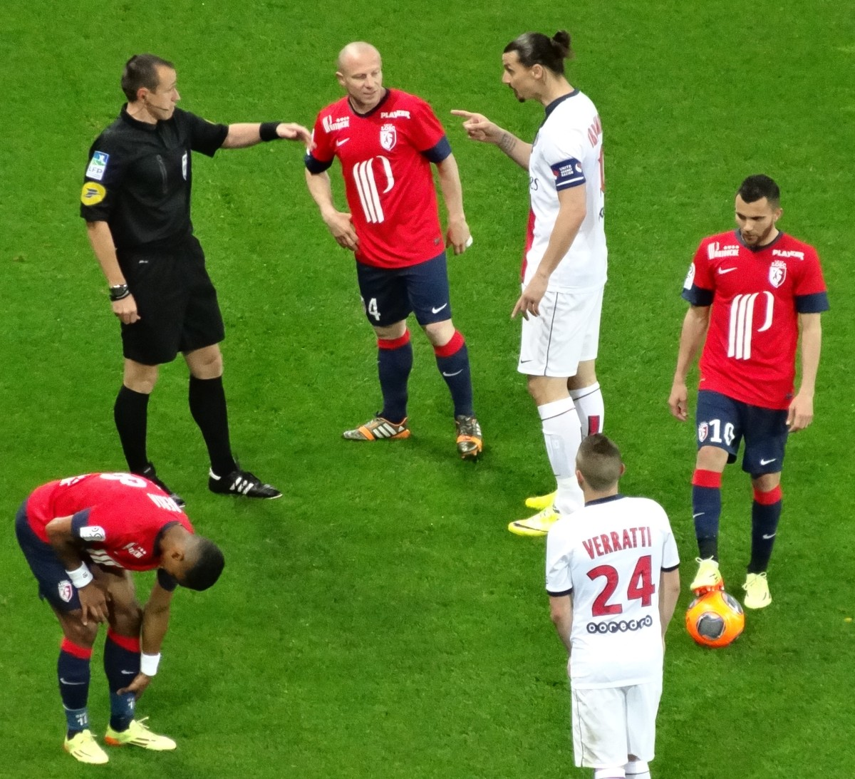 The referee may point at a player while talking with them as a warning, especially if the player is arguing.