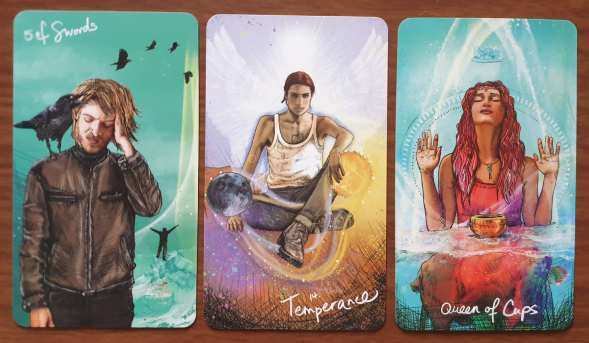 Five of Swords, Temperance and Queen of Cups from the Light Seer's Tarot. Photo by author.