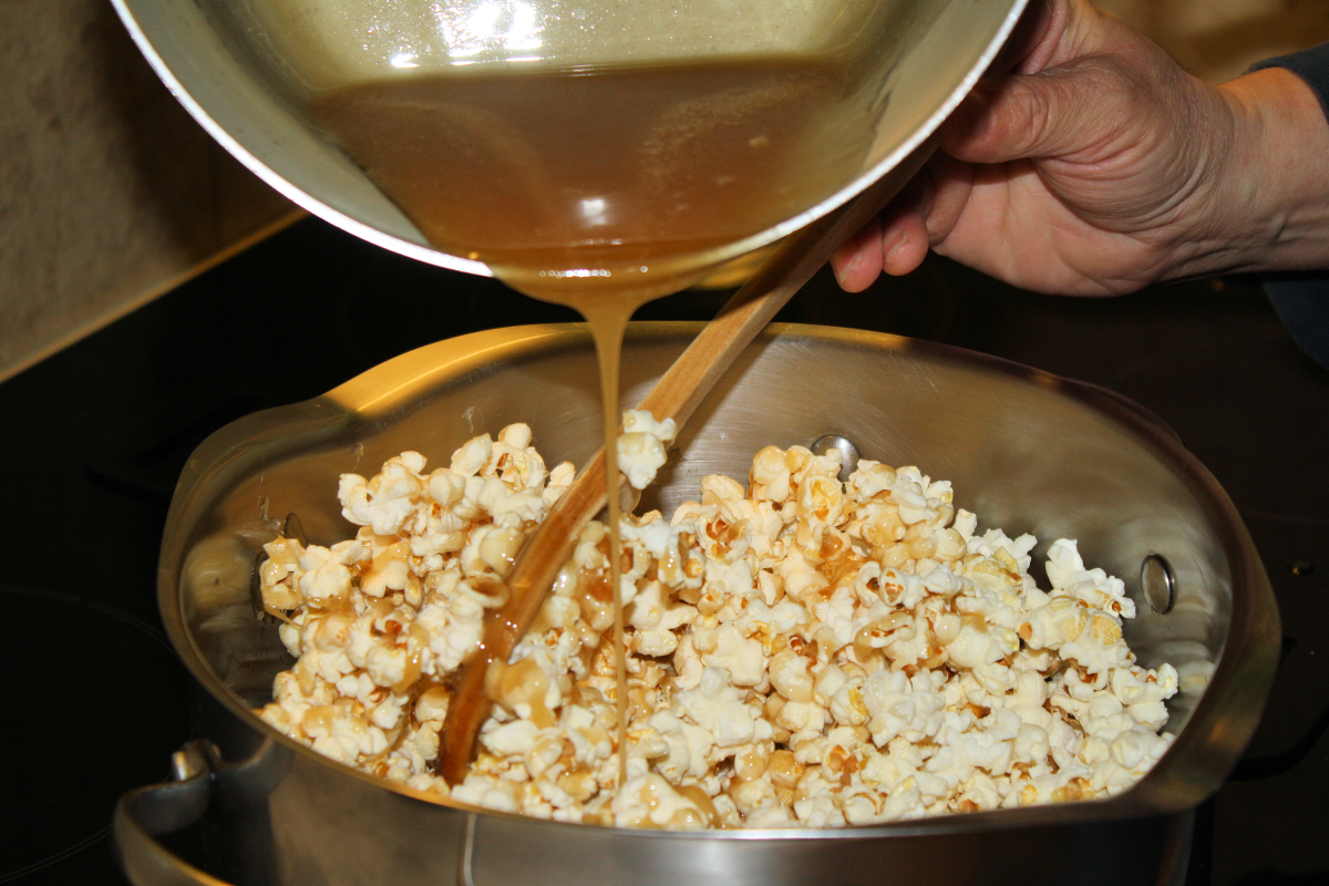Mixing syrup into popcorn