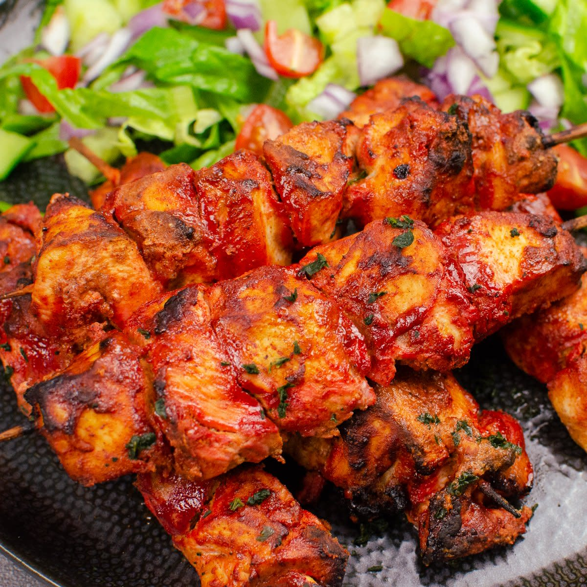 Traditional tandoori chicken tikka is red