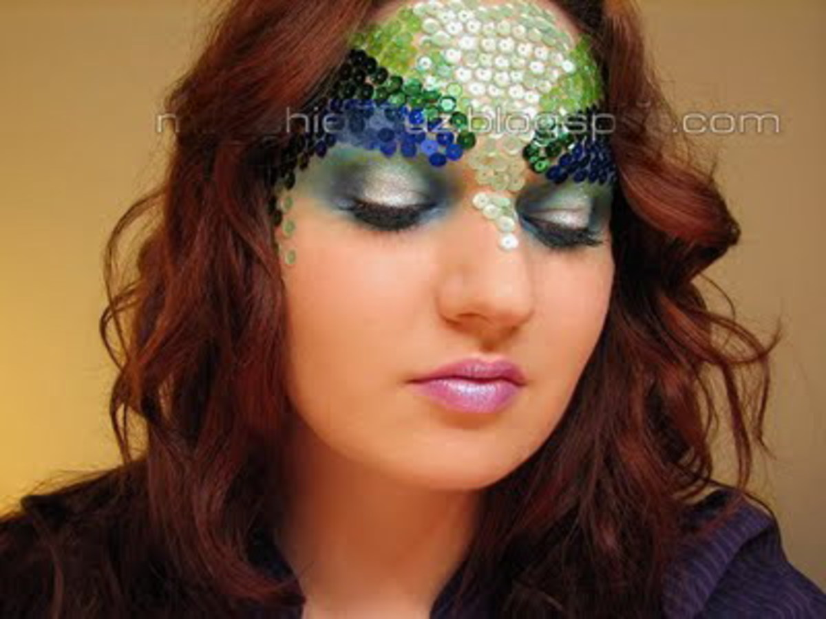 Sequin and stones pasted on the forehead and temple